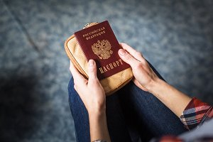 girl holding Russian passport