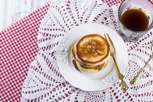 Stack homemade pancakes with coffee