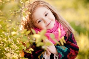 Smiling kid girl in park