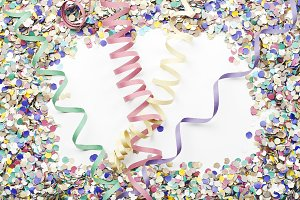 Background of confetti and serpentine. Copyspace. Carnival, party, celebration.