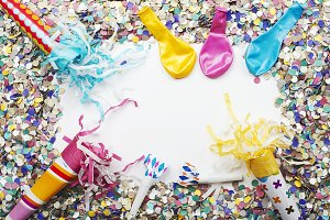 Background of confetti and balloons on white background. Carnival, party, celebration.