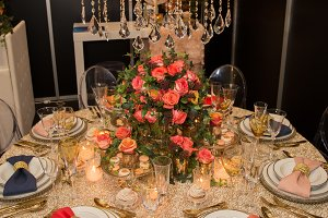 decorated  table with plates and serviettes