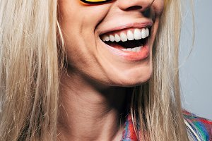 Laughing girl in sunglasses