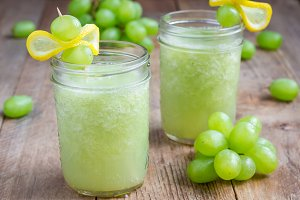 Healthy smoothie with green grape, lemon and honey, horizontal