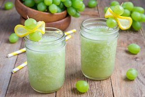 Healthy smoothie with green grape, lemon and honey