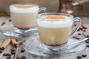 Coffee latte with cinnamon in glass cups