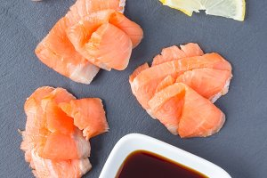 Smoked salmon filet with soy sauce on gray stone