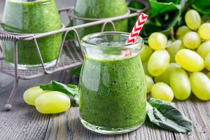 Healthy green smoothie with spinach, grape and banana