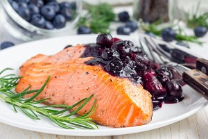 Baked salmon fillet with blueberry and rosmarin sauce, horizontal