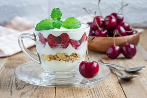 Cherry, muesli and yogurt dessert in glass, verrine, horizontal