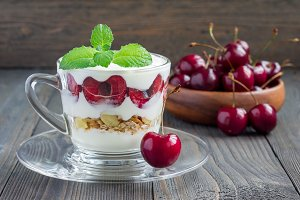 Cherry, muesli and yogurt dessert in glass, cherry verrine