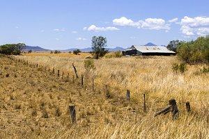 Old Rusty barn in a field