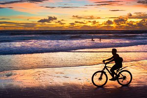 Cycling on the beach, silhouette