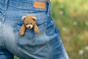 Teddy-bear in a pocket of jeans