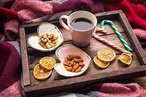 wooden tray with coffee, nuts