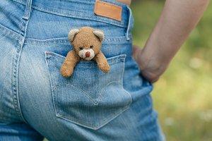 Teddy-bear in a pocket of jeans