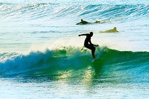 Surfers at sunset. Portugal