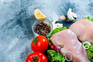 Raw chicken fillet with herb