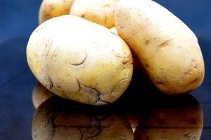 Potatoes on dark background