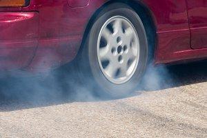 Rear wheel drive car burning tire