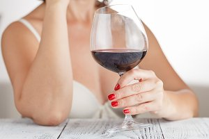 woman checks red wine