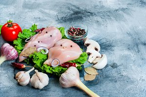 Raw chicken fillet with herbs