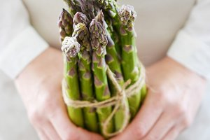 Woman's Hands Holding Asparagus