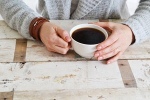 Woman's Hands Holding Cup of Coffee