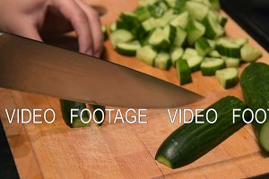 Timelapse of chopping cucumbers, close-up