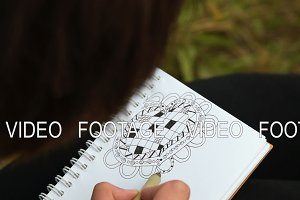 Woman drawing abstract heart pattern