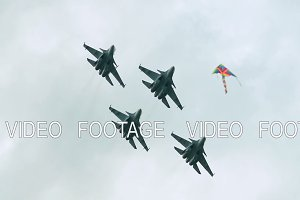 Four fighter jets in the air
