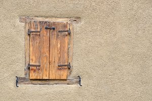 Wooden window on a wall