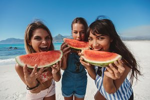 Three young women enjoy fresh