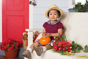Little girl with a pumpkin