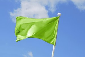 green Flag waving on the sky