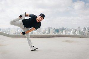 Bboy doing some stunts. Street artist breakdancing outdoors