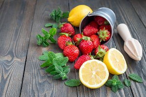 Ingredients for homemade strawberry lemonade on wooden table, copy space, horizontal