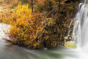 Autumn landscape with the waterfall