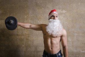 Fitness santa lifting weights