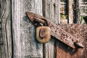 Old rusty metal padlock
