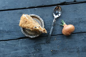 healthy food concept, cake and spoon on rustic wooden table