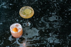 Two Cocktails on Dark Surface