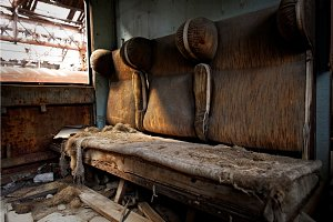 Damaged retro seats in a cabin