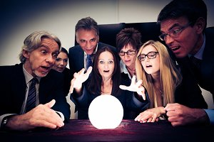 Business Team Using A Crystal Ball To Look Into Future