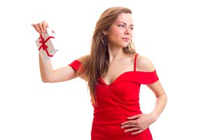 Young woman in red dress holding present