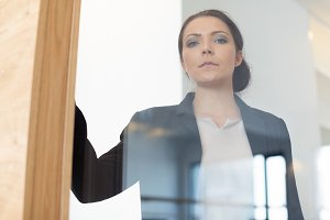 Businesswoman Looking Through Window