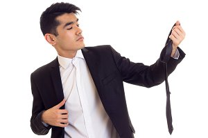 Young man in suit fixing his tie