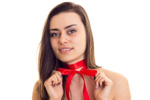 Young woman with red bowtie