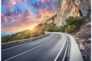 Beautiful asphalt road. Colorful landscape with high rocks
