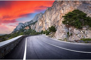 Mountain road with a perfect asphalt at sunset
